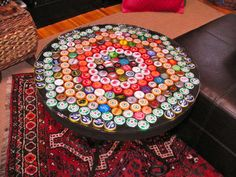 Bottle Cap Table with Poured Resin Surface  I was thinking of covering an old table on the deck with mosaics but this is more fun.