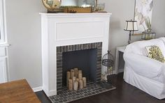 It's pretty common for small homes to be lacking a fireplace. Space is always an issue for builders, and it's a real shame because a fireplace adds more architectural interest to a home than almost… Faux Fireplace Mantels, Small Fireplace, Fireplace Ideas, Fireplace Decorations, Bedroom Candles, Bedroom Decor, Faux Fireplace Diy Cardboard, Shabby Chic Bedrooms, Small Spaces