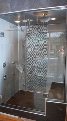 www.carolinawholesalefloors.com has more flooring and design ideas OR check out our Facebook!  Love this shower full of tile!
