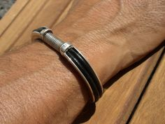 Hey, I found this really awesome Etsy listing at http://www.etsy.com/listing/78735904/men-black-leather-bracelet-with-silver