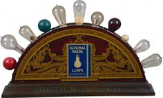 National Mazda Lamps Double-Sided Light-Up Tin Country Store Countertop Display w/ wood base & 11 different types of glass light bulbs w/ in...