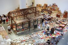 """This photo is from Song Dong's exhibit titled """"Waste Not.""""  This work contains various stuff spanning over 50 years belonging to Dong's mother.  Items range from pots and basins to blankets, oil flasks, and legless dolls, form a miniature cityscape that viewers can navigate around and through.  Even empty toothpaste containers, bottle caps, soda bottles, and much more.  This exhibit amazed me because of all the material Dong included."""