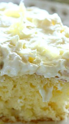 Pineapple Sunshine Cake ~ A light and fluffy pineapple-infused cake, topped with a sweet and creamy whipped cream frosting... Always a crowd pleaser!