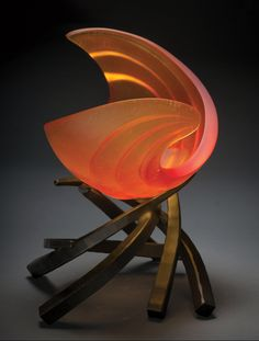 Hemisphere: Ripcurl by Brian Russell. Dramatic in size and simply riveting to behold, this sculptural bowl is a wave of fiery red and orange glass. It rests upon a forged steel base of swirling arcs that create a sense of visual movement. Crafted using the lost wax technique, the glass is given an acid polish for a satin finish. Limited edition of 100. Each is unique and will vary.