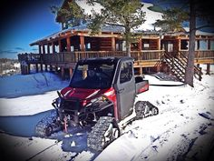 Polaris Ranger in front of our lodge.