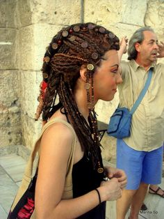 Egyptian hair dress wig done for the Opera Aida performed in Athens,Greece -  I like the braided dreadlocks and the medallions that are in the hairstyle are intriguing.