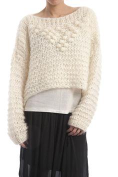 En smart og behagelig sweater som er strikket med store pinde