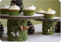 I'm not even a huge fan of decorating with moss, but I like these cake stands! Minus the pinecones, very spring-time!