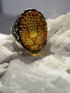 Genuine Carved Amber Jaguar Cat Ring by GriffinsNestJewelry on etsy