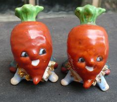 Vintage set of salt & pepper - little turnip people or possibly carrots.  Minor paint loss, gold trim paint, original cork stoppers.
