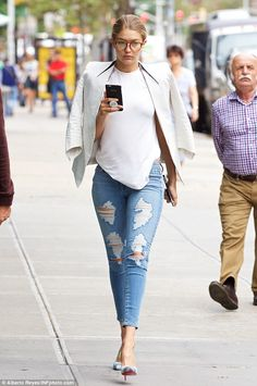 Specs appeal: Gigi Hadid stepped out with oversize glasses on Friday in NYC...