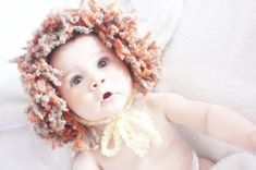 Toddler lion bonnet costume head piece in yellow with plaited ties and a big furry orange and brown mane. Handmade with love by Babamoon - size 12 to 24m - can be made in other colours and sizes!