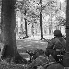 A Piat (Projector, Infantry, Anti-Tank) gun of C Troop of the 1st Airlanding Reconnaissance Squadron covers a road near Wolfheze in Holland during Market Garden (September 18, 1944). The PIAT was a British portable anti-tank weapon developed during World War II. It was designed in 1942 in response to the British Army's need for a more effective infantry anti-tank weapon, and entered service in 1943.