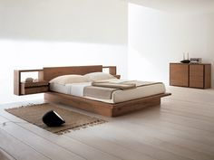 solid wood platform bed design with integrated side tables hand knitted mat for bedroom simple & minimalist console table of Feel Your Ultimate Sleeping with These Tens of Cozy & Simple Wood Bed Design Platform Bed Designs, Modern Platform Bed, Platform Bed Frame, Wood Bed Design, Bedroom Bed Design, Modern Bedroom, Bedroom Simple, White Bedroom, Bedroom Ideas