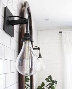 Industrial bathroom sconce | See this Instagram photo by @beginninginthemiddle