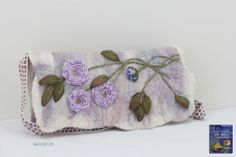 Good afternoon stitching world ^•^   I have a new concept to show you today which may inspire you to make a lovely gift for yourself or for that special person in your life… a lustrous sling   clutch bag with silk roses on felted wool and silk.