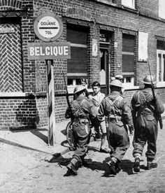 Three British soldiers pass a Belgian boy at the French-Belgian border (May At this time the Germans had already broken through in the Ardennes and were driving toward the Channel. British Soldier, British Army, Army Infantry, Ardennes, Battle Of Britain, France, D Day, Military History, World War Two