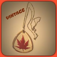 VINTAGE LUCITE MAPLE LEAF PENDANT You won't see this on anyone else! Maple leaf is crystal clear. Sized next to a Liberty dollar. Tx for browsing! Marian Remember to bundle for 25% off✨✨✨ Vintage Jewelry Necklaces