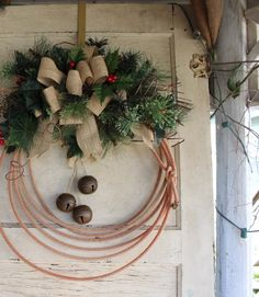 Jingle bell western lariat rope wreath for a Merry Cowboy Christmas. A cowboy, rustic burlap wreath
