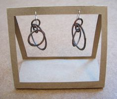 adorable little cardboard earring display (don't worry, it's the earrings that are for sale, not the stand!)