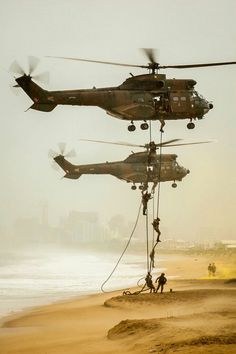 Oryx helicopters rappelling troops during a mock beach assault at Armed Forces Day Navy Military, Military Art, Military Soldier, Military Helicopter, Military Aircraft, Air Force Day, Soldier Drawing, South African Air Force, Air Force Aircraft