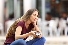 Sad girl waiting for a mobile phone call or message from her boyfriend sitting in a bench outside in the street with an urban background Phone Call Quotes, Text Back, Losing A Loved One, Relationship Problems, Relationship Tips, Relationships, Take Risks, Sad Girl, Text You