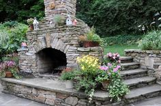 eclectic stone backyard fireplace brown design group 9779 Series   Backyard Landscaping Ideas : Fireplaces