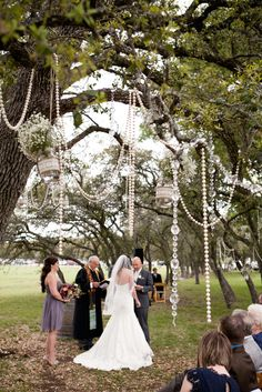 @TheresaBot we HAVE HAVE HAVE to hang pearls from the trees for your wedding!!!
