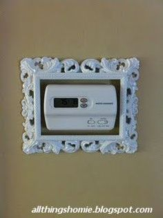 Such a cute idea!! Painted picture frame around the thermostat.: