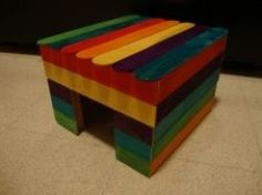 A house made from popsicle sticks... This looks easy to make for a small pet but what kind of glue?