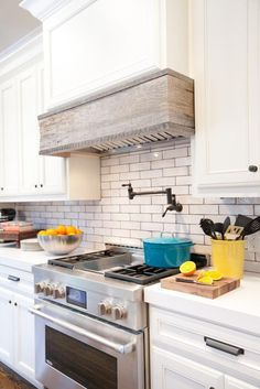 Awesome Kitchen Vent Hoods For Your Kitchen Design: Traditional Scandinavian Kitchen With White Cabinet And White Tile Backsplash Plus Under Cabinet Kitchen Vent Hoods Design Source by clairebunn . Kitchen Hood Design, Kitchen Vent Hood, Interior Design Kitchen, Wood Hood Vent, Kitchen Range Hoods, Stove Vent Hood, Aga Stove, Stove Hoods, Kitchen Exhaust
