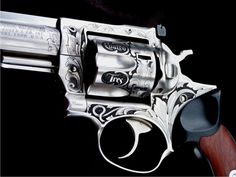 Ruger GP 100 .357 Magnum.  By Otto Carter- a Master Engraver.   Wish I could do stuff like that