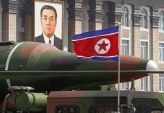 In this photo taken on April 15, 2012, what appears to be a new missile is carried during a mass military parade at the Kim Il Sung Square in Pyongyang, North Korea. The photo shows the warhead's surface is undulated, suggesting it's a thin metal sheet unable to withstand flight pressure, analysts say.