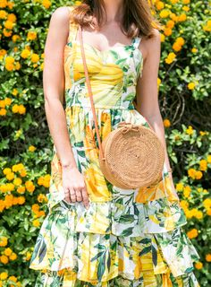 Sydne Style wears straw circle bag from bali for summer handbag trends