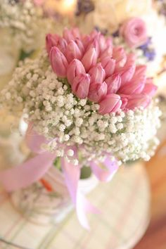 Pink tulips and baby breaths wedding bouquet
