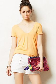 I use this V neck with everything- half tucked in jeans, tucked in skirts, over leggings- it's so versatile