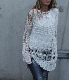Cotton Sweater in Ivory cream  with an asymmetrical hemline.
