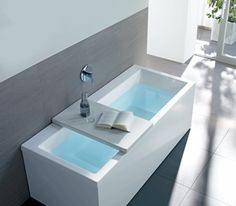 Tray/bench could make it easier to get into the tub and easier to reach things you need.
