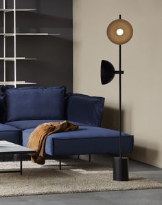 A floor lamp with a blue velvet sofa in a living room. There is aYou can find Lightning and more on our website.A floor lamp with a blue velvet sofa in . Danish Furniture, Furniture Design, Photo Lamp, Studio Lamp, Blue Velvet Sofa, Living Spaces, Living Room, Modular Sofa, Furniture Inspiration