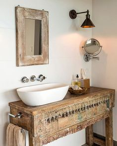 This boho bathroom is understated in terms of color but so very boho with its vintage, arty feel.  Lovely!