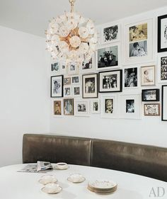 At home with Darcy Miller Nussbaum and Andrew Nussbaum: Martha Stewart's Darcy Miller Nussbaum's New York apartment by architect David Mann. Décoration New York, New York Loft, Ny Loft, Vintage Pendant Lighting, Vintage Chandelier, Flower Chandelier, Hanging Photos, Wall Photos, Photo Displays
