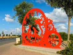 Time Chasers, Ashkelon, Israel.  Painted Metal  Sculpture by Uri Dushy