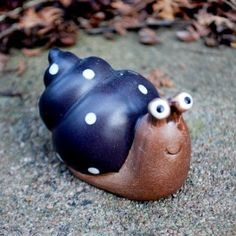 Terracotta garden snail ornament  Glazed finish  Size 5cm tall, 4.5cm wide, 8cm long  Perfect to hide around the garden for a fun look  Check out our full range of modern Ornaments for the garden £3.99