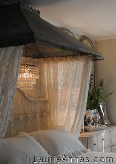 This incredible bed canopy was made out of lace curtains and a zinc hood range