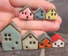 Instant collection of my hand formed miniature houses - made with stoneware clay and bright glazes. Stamped windows and doors, textured roofs. Houses stand only 12 - 29 mm or 0.5 - 1.2 in. tall. Each little house is signed (Sz) on the bottom.    Shipping fee is for first class airmail. Registration (tracking) upon request for additional 5 euros.
