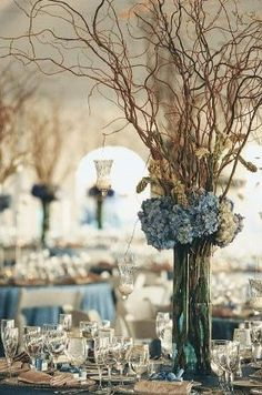 Rustic Centerpieces with blue hydrangea and curly willow by ila