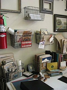 Small wire baskets for wall storage - keeps everything at your finger tips!