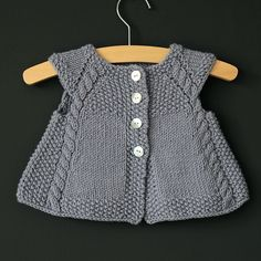 This charming cap-sleeved, swingy cardigan is the perfect timeless piece to add to any little girl's summertime wardrobe, or as an extra layer in the Fall. Lovely over a crisp white dress, it is also comfortable enough to be paired with everyday play clothes.