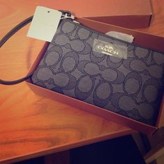 Black Coach wristlet Brand new with tags, zipper pouch with wrist strap, two card slots on inside Coach Bags Clutches & Wristlets