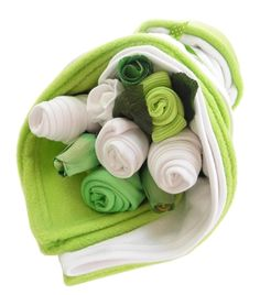 This lovely bundle of baby clothes is styled like our traditional flower arrangements but with added extras and a bright lime twist.  Filled with baby socks, bibs, bodysuit, hat, scratch mitts, fleece blanket and soft hooded bath towel, it's complete with artificial greenery and flowers. This gorgeous lime baby bundle is a perfect gift for any newborn.